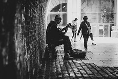 a short story about music bouncing off the bricks (ignacy50.pl) Tags: blackandwhite monochrome music guitar streetart streetmusic bricks wall people reportage citylife silhuette