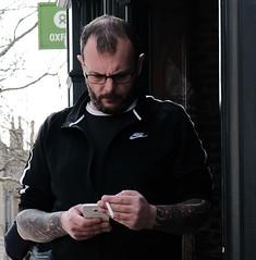 Smoke and Text (Bury Gardener) Tags: burystedmunds suffolk streetphotography street streetcandids snaps strangers candid candids people peoplewatching folks 2019 england eastanglia uk britain fuji fujixt3 fujifilm cornhill