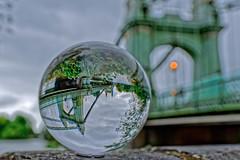 Ball Natural (Croydon Clicker) Tags: glassball crystalball reflection bridge light sky cloud river thames hammersmith london wall