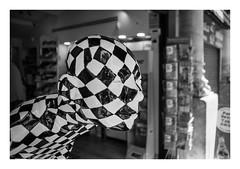 FILM - Chequerboard face (fishyfish_arcade) Tags: 35mm analogphotography bw barcelona blackwhite blackandwhite cimko28mmf28 filmphotography filmisnotdead hp5 istillshootfilm monochrome olympusom10 analogcamera film ilford mono chequerboard ilfordhp5