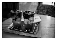 FILM - Chilled (fishyfish_arcade) Tags: 35mm analogphotography bw barcelona blackwhite blackandwhite cimko28mmf28 filmphotography filmisnotdead hp5 istillshootfilm monochrome olympusom10 analogcamera film ilford mono drinks ice fruit ilfordhp5