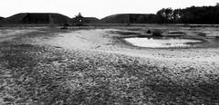 Empty cruise missile bunkers (a.pierre4840) Tags: olympus om3 zuiko 24mm f28 35mmfilm kosmofotomono100 landscape bw blackandwhite noiretblanc berkshire england abandoned ruined derelict