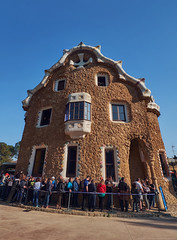March 2017, Barcelona, Spain - Casa del Guarda in the Park Guell with a queue of tourists with unrecognizable blurred faces. . People standing at the Gatehouse of Antoni Gaudi in Barcelona. (Midoritai) Tags: casa guarda park guell queue tourists people standing gatehouse antoni gaudi barcelona gatekeeper house building landmark tourism spain catalonia gingerbreadhouse attraction waiting entrance trencadis technique art architecture facade modern modernism artist travel famous mosaic broken pottery tile orange summer crowd unusual masterpiece spring sunny pavilion architect gate caretaker design guel