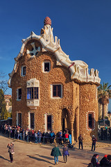 March 2017, Barcelona, Spain - Casa del Guarda in the Park Guell with queue of tourists. People standing at the Gatehouse of Antoni Gaudi in Barcelona. (Midoritai) Tags: casa guarda park guell queue tourists people standing gatehouse antoni gaudi barcelona gatekeeper house building landmark tourism spain catalonia gingerbreadhouse attraction waiting entrance trencadis technique art architecture facade modern modernism artist travel famous mosaic broken pottery tile orange summer crowd unusual masterpiece spring sunny pavilion architect gate caretaker design guel