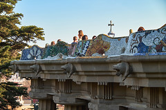 The mosaic trencadis border of the colorful ceramic serpentine bench on the central terrace of the famous Park Guell. Doric columns with creature heads. (Midoritai) Tags: mosaic trencadis border colorful ceramic serpentine bench central terrace famous park guel doric columns creature head lion tile antoni antonio architect architecture art artistic artwork barcelona guell glass gaudi unique technique design broken top unusual modernism sunset puzzle spain landmark tourism tourists attraction pattern sculpture abstract travel catalonia museum snake