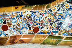 Details of trencadis mosaic of the ceramic serpentine bench at the central terrace of Park Guell designed by Antoni Gaudi, Barcelona, Spain. (Midoritai) Tags: barcelona park abstract broken glass architecture bench tile square ceramic spain artwork ceramics terrace mosaic decorative details famous central landmark gaudi technique guell antoni serpentine designed guel trencadis travel art tourism museum modern artist pattern tour miracle snake decoration modernism catalonia architect part pottery refuse masterpiece touristic facing fragment fractured