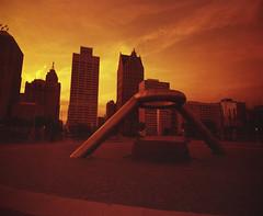 Explore Detroit - Lomography Redscale (IV2K) Tags: lomography redscale lomographyredscale film 120film mamiya mamiya7 mamiya7ii exploredetroit nothingstopsdetroit motorcity motorcityshooters mediumformat michigan hart hartplaza generalmotors red ishootfilm istillshootfilm