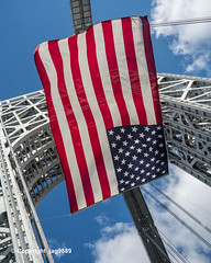 American Flag at the New Jersey Tower of the George Washington Bridge (jag9889) Tags: 07024 2019 20190614 americanflag bergencounty bridge bridges bruecke brücke crossing flag fortlee gw gwb gardenstate georgewashingtonbridge holiday hudsonriver infrastructure k007 manhattan nj ny nyc newjersey newyork newyorkcity outdoor pont ponte puente punt river span structure suspensionbridge tower usa unitedstates unitedstatesofamerica uppermanhattan wahi washingtonheights water waterway jag9889 zip07024