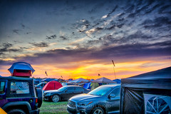 Bonnaroo Sunset, 2019.06.15 (Aaron Glenn Campbell) Tags: 3xp hdr ±3ev bonnaroo tents sigma wideangle 19mmf28exdn coffeecounty tennessee manchester thefarm vip festival macphun skylum aurorahdr middletennessee sunset sunshade popups flags evening sky clouds vehicles primelens emount colorful vibrant vivid tentcamping