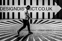 Design District (Sean Batten) Tags: london england unitedkingdom greenwich o2 blackandwhite bw streetphotography street candid person walking city urban fuji fujifilm x100f eastlondon docklands