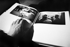 Flicking Through Winogrand (Bosscat2) Tags: photobook winogrand kentmere400 35mmfilm id11 nikonf90x nikkor28mm hand
