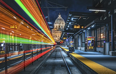 downtown st. paul, saint paul, minnesota, mn (Dan Anderson.) Tags: downtown stpaul saintpaul minnesota mn lightrail station train greenline longexposure blue gold night minneapolis metro lighttrails motion speed lights red capitol building minnesotastatecapitol transportation movement dananderson sincity