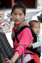 A young Hmong mother with a baby in Sa Pa, Vietnam (adamba100) Tags: asia asian china chinese korea korean mongolia mongolian vietnam vietnamese thai beijing town city view landscape cityscape street life lifestyle style people human person man men woman women male female girl boy child children kid interesting portrait innocent cute charm pretty beauty beautiful innocence play face headshot pure purity tourism sightseeing tourist travel trip light color colour outdoor traditional cambodia cambodian phnom penh sony a6300 18105 siem reap pattaya bangkok field gate architecture tree building