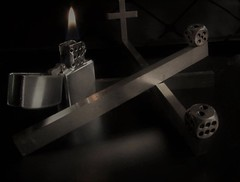 The Eleventh Hour (Rand Luv'n Life) Tags: odc our daily challenge round dice cigarette lighter flame cross crucifix steel beams sharp edge reflection angles geometrical black background the eleventh hour parable mathew 20116 indoor composition diffused lighting