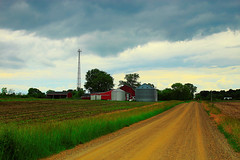 Not Remote (stephen.michaels) Tags: michigan dirtroad rural clouds cloudy rain farm farming agriculture barn tokinaaf1931935mmf3545 canoneosrebelt5 gimp