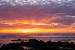 Sunset on the Rocks (Michael Guttman) Tags: newport oregon nyebeach sunset ocean clouds rocks silhouette sunsetcolors
