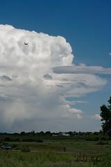 Plane Flies Around Thunderhead (dcstep) Tags: cherrycreekstatepark colorado sonya7riii fe100400mmf4556gmoss allrightsreserved copyright2019davidcstephens handheld dxophotolab na naturesanctuary dsc8332dxo cloud sky plane thunderhead blue white