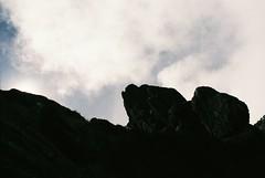 Shaded (IggyRox) Tags: peru andes mountains southamerica film 35mm hike trek nature beauty highaltitude huaripampa ancash alpamayotrek parquenacionalhuascaran shade rest clouds sky sun block morning shadow silhouette color