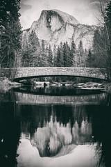 January (Thomas Hawk) Tags: america california nationalpark usa unitedstates unitedstatesofamerica yosemite yosemitevalley bridge bw reflection river water fav10 fav25 fav50 fav100