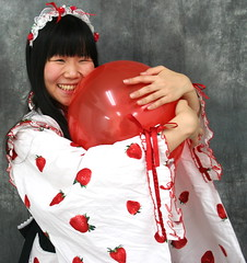 Gonna Hug It Better! (emotiroi auranaut) Tags: woman lady girl beautiful model pretty cute attractive nice sweet happy happiness round red toy balloon big hug hugging embrace embracing squeak robe strawberries bonnet cherries