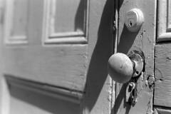 Locked Out (macromary) Tags: analog florida foma fomapan fomapan100 blackwhite analogphotograph bw blackandwhitefilm filmcamera film mechanicalcamera vintage vintagecamera rodinal 35mm nikkor 50mm 50mmlens 35mmfilm f14 nikonf100 f100 nikon monotone light shade shadow fl abandoned urbex flurbex rurex alachuacounty marthaperryinstitute derelict empty