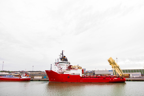 Small red cargo ship in Danish shores