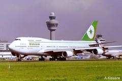 EVA AIR B747 B16465 (Adrian.Kissane) Tags: aviation runway airport departing takeoff grass sky outdoors jumbojet 747 boeing aircraft plane aeroplane 26062 b16465 1999 b747 evaair amsterdam