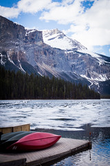 Emerald Lake (ellieupson) Tags: canada emeraldlake britishcoloumbia nationalpark yoho lake mountain ice canoe red melting