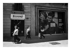 FILM - Laughing as the world goes by (fishyfish_arcade) Tags: 35mm analogphotography bw barcelona blackwhite blackandwhite cimko28mmf28 filmphotography filmisnotdead hp5 istillshootfilm monochrome olympusom10 analogcamera film ilford mono streetphotography