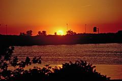 Setting Sun Over Sandusky Bay (craigsanders429) Tags: sunsetphotography sunsets sunset sunsetcolors sanduskybay sun water ohio