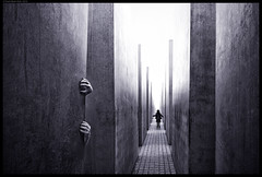 A Dark Vision III (frankmartinroth) Tags: sony a7r3 15mm f45 voigtlander monochrome bw wide berlin memorial germany hands silhouette vanishingpoint outdoor mysterious child lines geometry concreteblocks