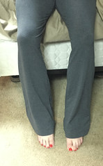 Yoga pants and red toes (devistating) Tags: men man feet foot painted nails toes red yoga pants