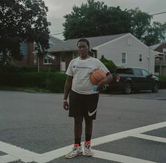 yonkers, new york (J.K.Stevens) Tags: mamiyac220 mamiya mediumformat kodak kodakportra400 kodakportra160 square 120mm analog america street streetscape tlr twinlensreflex vintagecamera yonkers newyork thebronx portrait kid teen basketball youth