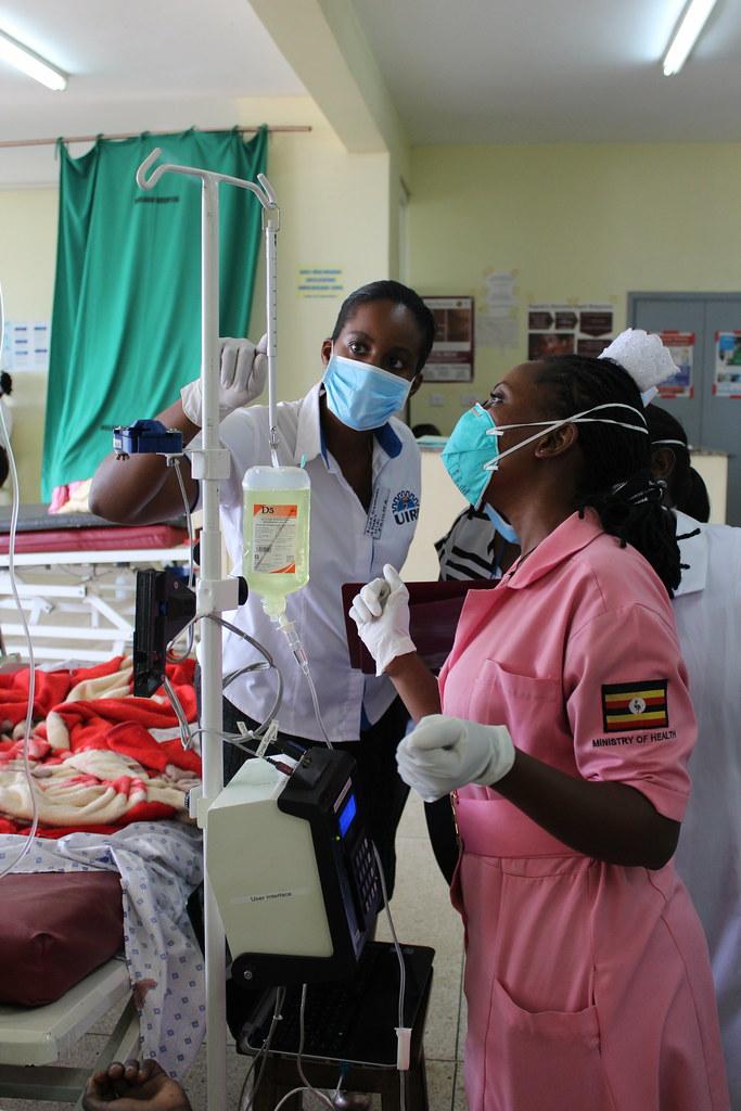 Philippa Makobore – project lead with a clinical study nurse (Winnie Kibirige)