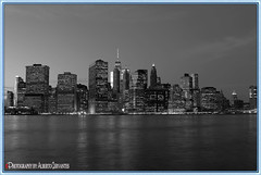MANHATTAN. NEW YORK CITY. (ALBERTO CERVANTES PHOTOGRAPHY) Tags: manhattan usa nyc newyork city lowermanhattan lower monochrome blackwhite black white streetphotography photography photoborder photoart art creative water building torre tower reflejo reflection nightcolor colornight colorlight night nightscapes cityscapes skyline skyscraper landscapes sky nubes clouds indoor outdoor blur light color colores colors brillo bright brightcolors nocturno wtc worldtradecenter freedomtower waterfront retrato portrait flickrunitedaward award united flickr
