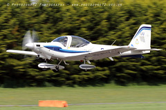 0867 Tutor Takeoff (photozone72) Tags: raf tutordisplay grobtutor tutor wingswheels dunsfold dunsfoldpark aviation aircraft airshows airshow canon canon7dmk2 canon100400f4556lii 7dmk2