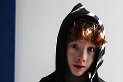 seven (clementines71) Tags: kid child people growing eating messy face hood blue simple redhead ginger light stripes shadows