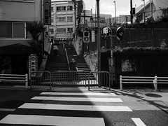 walking in and out of shadow (peaceblaster9) Tags: street shadows lights people walking higashinakano tokyo steps stairs ストリート 光 影 街中 東中野 東京 階段 blackandwhite bnw bw blackwhite monochrome