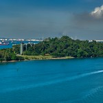 Sentosa island and ships in the roadstead seen from cable car coming from Mount Faber in Singapore thumbnail