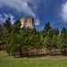 A Backdrop of Blue Skies and Clouds for Devils Tower (Bear Lodge)