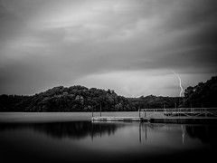 Calm Before the Storm (TnOlyShooter) Tags: storm lightning lake pier dock clouds em1markii 17mmf18 mirrorless livecomposite olympus blackandwhite