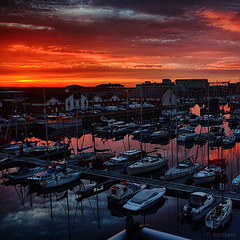 twilight (amazingstoker) Tags: hartlepool marina county durham north sun glow reflection yacht boat harbour harbor clouds skyline sea twilight set red
