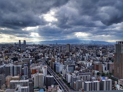 Osaka cityscape on a cloudy day (tomquah (busy period)) Tags: osaka tomquah weather cityscape japan sunray crepuscularrays sonyrx100 sonyrxmoments