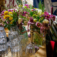 Still life with flowers, glasses, and candles (FlickrDelusions) Tags: stilllife circus flowers giffordscircus olympusuk xanadu candles universityparks oxford england unitedkingdom