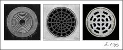 I Finally Got A Round Tuit (Simon Caplan) Tags: circle detail urbandetail urbanfragment urbanabstract mundanedetails metal metallic rusty rustymetal mono monochrome monotone triptych trio three squaredcircle square streetfurniture bristol bristolengland bristoluk