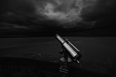 """on the ramparts of Mont Saint Michel you don't need the telescope to see the storm coming. Fine art black & white, Manche, Normandie, France (grumpybaldprof) Tags: """"montstmichel"""" """"stmichael'smount"""" avranches manche normandy france tidal island sea abbey """"bayeuxtapestry"""" monastery """"8thcentury"""" unesco """"worldheritagesite"""" fortifications """"quicksand"""" castle ramparts telescope storm clouds threatening bw blackwhite """"blackwhite"""" """"blackandwhite"""" noireetblanc monochrome """"fineart"""" striking artistic interpretation impressionist stylistic style contrast shadow bright dark blackmood moody atmosphere atmospheric canon 70d """"canon70d"""" sigma 1020 1020mm f456 """"sigma1020mmf456dchsm"""" """"wideangle"""" ultrawide"""