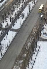 _C010322 (Wormsmeat) Tags: riga latvia architecture urban cold snow olympus penf 12100mzuikopro bus coach yellow busstop trees baretrees diagonal