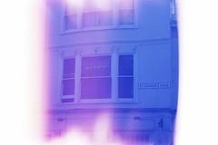 Flag in Window (andy broomfield) Tags: film filmisnotdead filmphotography 35mm dubblefilm colourfilm c41 dubblefilmapollo brighton brightonhove lightleak