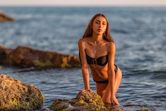 Diana (The Painter) (mikhailkorzhalov) Tags: canon canon135mmf2lusm 6d 135mm f20 beach sea rocks water stone nature naturallight sunset sunsetlight girl beautifulgirl beautifulpeople model lady posing pretty skin cute cutegirl young crimea summer outdoors longhair bikini tannedskin sevastopol