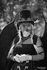 Winged Steampunker (nigelboulton72) Tags: stempunk blackandwhite angel wings lady hat goggles